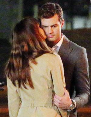 Dakota johnson and jamie dornan kiss on the vancouver set of 50 shades