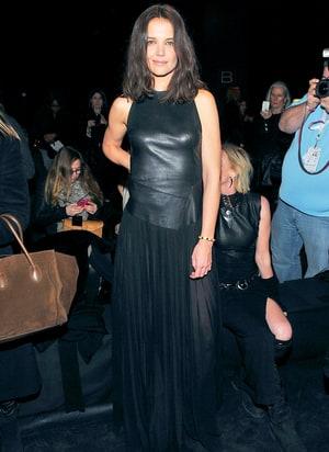 Katie Homes Wears See Through Skirted Dress At Donna Karan
