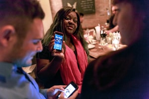 Patrons use Tinder, the online dating app, while at Bondurants, a bar in New York, Feb. 5, 2015. Tinder, the dating app that replaced profiles and algorithms with streams of photographs, has become a fixture of the online dating scene.