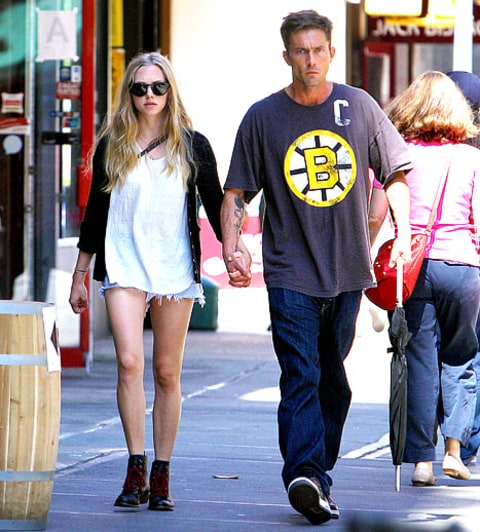 amanda seyfried and desmond harrington hold hands while