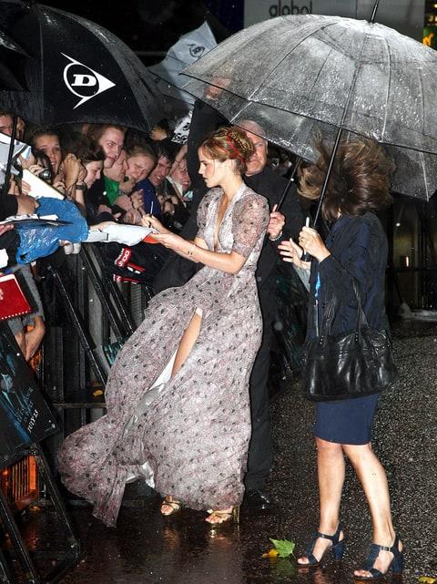 Emma Watson suffers a wardrobe malfunction as her backless dress 80