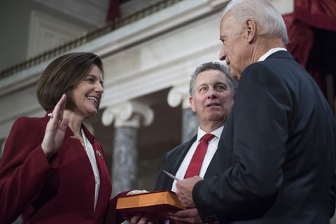 Washington, District of Columbia, U.S. - UNITED District of ColumbiaS - JANUARY 03: Sen. Catherine Cortez Masto, D-Nev., is administered an oath as her husband Paul looks on, by Vice President Joe Biden during a swearing-in ceremony in the Capitol's Old Senate Chamber, January 03, 2017.