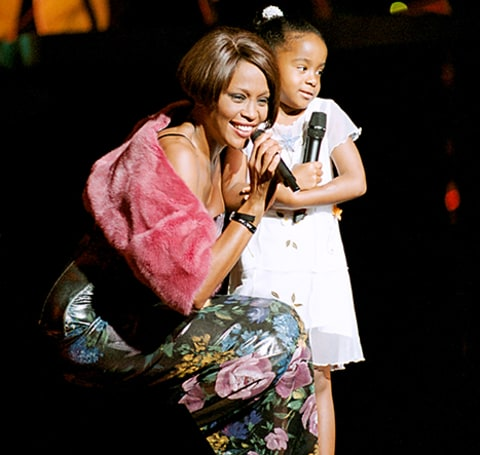 Whitney Houston with her daughter Bobbi Kristina Brown onstage