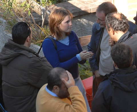 Amanda Knox at crime scene with Police