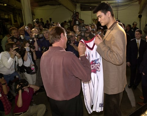 Houston Rockets holds his jersey after singing to the Houston Rockets, 2002