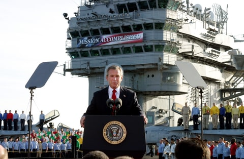 President Bush declares the end of major combat in Iraq as he speaks aboard the aircraft carrier USS Abraham Lincoln off the California coast, in this May 1, 2003 file photo.