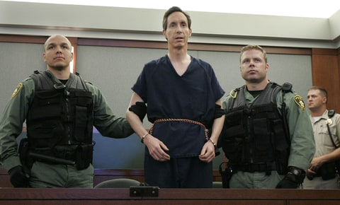 In this Aug. 31, 2006 file photo, Warren Jeffs appears in a courtroom surrounded by guards in Las Vegas. The Utah Supreme Court on Tuesday, July 27, 2010 reversed the convictions of polygamist leader Warren Jeffs and ordered a new trial.