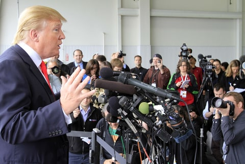 Donald Trump, a possible 2012 presidential candidate, talks to reporters after arriving at the Pease International Tradeport Wednesday, April 27, 2011 in Portsmouth, N.H. Trump said he was