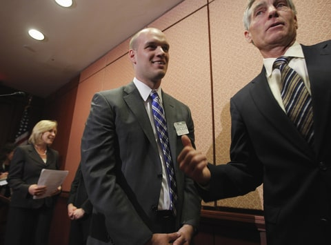 en. Mark Udall, D-Colo., right, walks with Air Force 1st Lt. Josh Seefried from Longmont, Colo., during a news conference on Capitol Hill in Washington, Tuesday, Sept. 20, 2011, to mark the end of