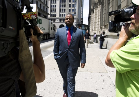 Baltimore police Officer William Porter, one of six Baltimore city police officers charged in connection to the death of Freddie Gray, leaves the courthouse, after testifying in the trial of Officer Caesar Goodson, Monday, June 13, 2016, in Baltimore Md. Porter's trial in the Gray case ended in mistrial. He will be tried again in September.