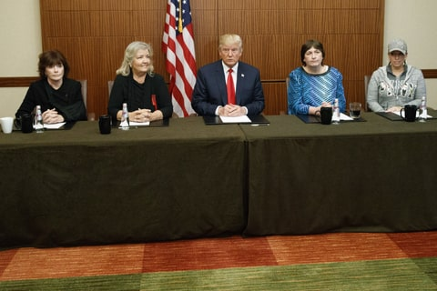 Republican presidential candidate Donald Trump, center, sits with, from right, Paula Jones, Kathy Shelton, Juanita Broaddrick, and Kathleen Willey, before the second presidential debate with democratic presidential candidate Hillary Clinton at Washington University, Sunday, Oct. 9, 2016, in St. Louis.