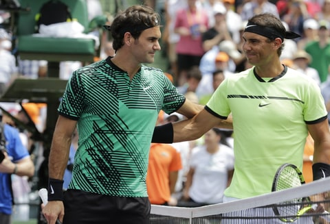 Roger Federer poses with Rafael Nadal during the Men's finals at the Miami Open held at the Crandon Park Tennis Center on April 2, 2017 in Key Biscayne, Florida