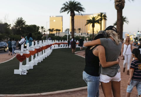 A memorial displaying 58 crosses by Greg Zanis stands at the Welcome To Las Vegas Sign on Thursday, October 5, 2017, in Las Vegas. Each cross has the name of a victim killed during the mass shooting at the Route 91 Harvest country music festival this past Sunday. Dozens of people were killed and hundreds were injured.