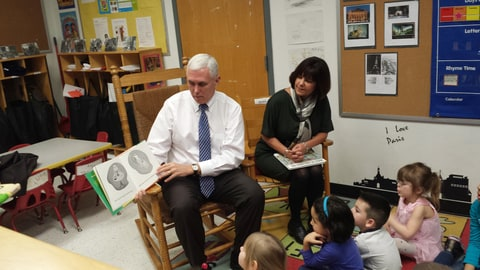 Gov. Mike Pence and First Lady Karen Pence read to children at the Day Nursery daycare in Indianapolis. Pence is seeking a pilot program that would help pay to send children to preschools and other daycare centers that offer early learning programs. (AP Photo/Tom LoBianco)Indiana Gov. Mike Pence and First Lady Karen Pence read to children at the Day Nursery daycare in Indianapolis on Monday, March 3, 2014. Pence is seeking a pilot program that would help pay to send children to preschools and other daycare centers that offer early learning programs.