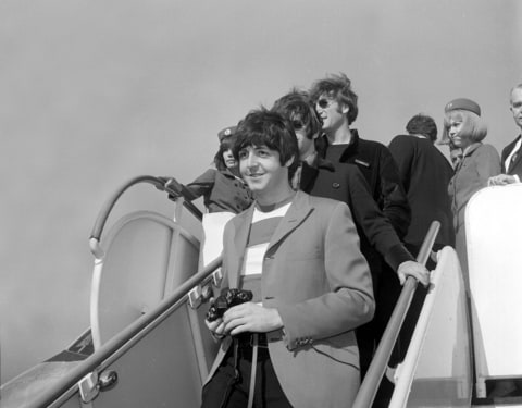 Paul McCartney, followed by Ringo Starr and John Lennon of the Beatles, arrive by plane at San Francisco International Airport on Aug. 29, 1966. The four-member British band will perform tonight at Candlestick Park.