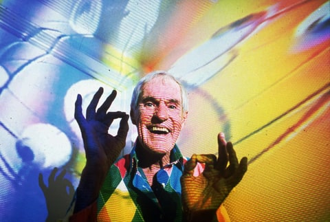 Timothy Leary, the former LSD experimenter turned computerized hallucination designer, is photographed in his Beverly Hills, Ca., home in July 1992 with video images from his show projected over him.