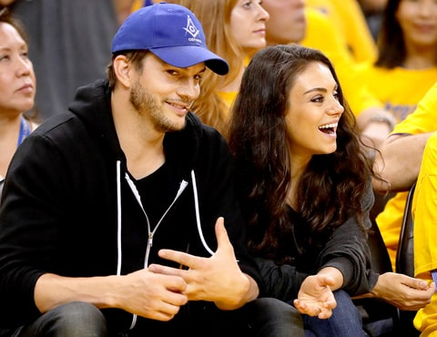 Ashton Kutcher and Mila Kunis attend Game 2 of the 2016 NBA Finals between the Golden State Warriors and the Cleveland Cavaliers at ORACLE Arena on June 5, 2016 in Oakland, California.
