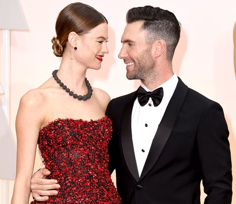 Behati Prinsloo and Adam Levine arrives at the 87th Annual Academy Awards.