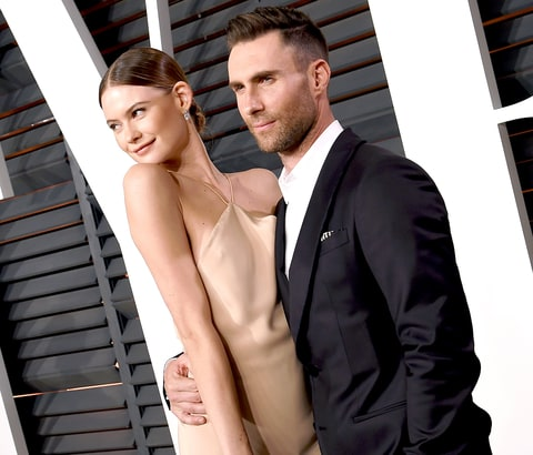 Behati Prinsloo and Adam Levine attend the 2015 'Vanity Fair' Oscar Party, hosted by Graydon Carter, at the Wallis Annenberg Center for the Performing Arts on Feb. 22, 2015, in Beverly Hills.