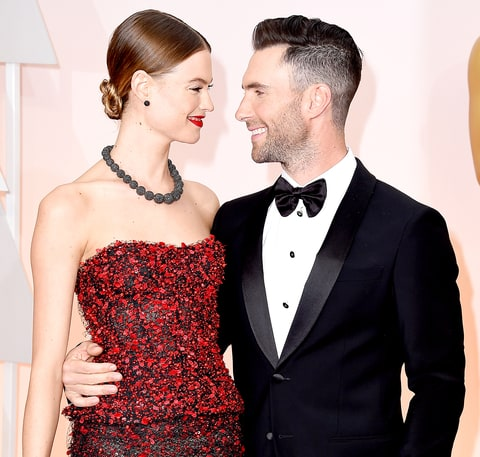 Adam Levine (R) and Behati Prinsloo attend the 87th Annual Academy Awards at Hollywood & Highland Center on February 22, 2015 in Hollywood, California.