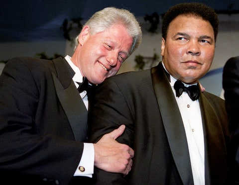 Bill Clinton leans on former world boxing heavyweight champion Muhammad Ali at the National Italian American Foundation 25th Anniversary Awards Gala Dinner at a Washington, D.C. hotel, Oct. 28, 2000.