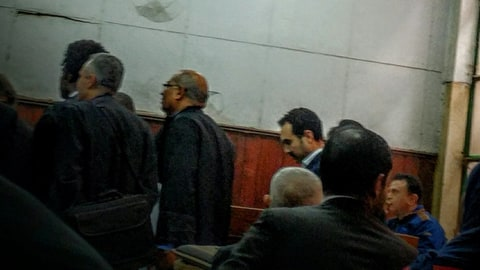 "Egyptian author Ahmed Naji, center background, attends a court hearing in Cairo, Egypt, Saturday, Feb. 20, 2016.  Naji was sentenced to two years in jail on Saturday by a Cairo appeals court for publishing a sexually explicit excerpt of his novel that prosecutors said violated ""public modesty.""  Naji was initially acquitted by another court, but prosecutors appealed the verdict."