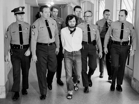 Seven deputies escort Charles Manson in 1971 from the courtroom after he and three followers were found guilty of seven murders in the Tate-LaBianca slayings.