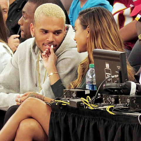 chris and karrueche at basketball game