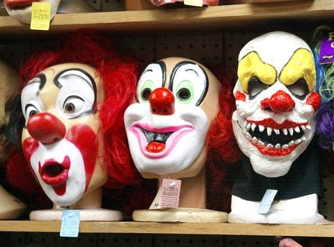 Clown masks on display.