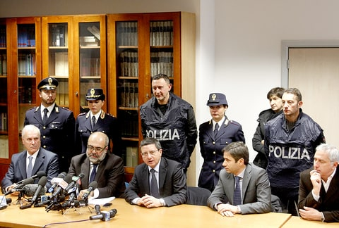Members of the media attend a news conference by Florence chief prosecutor Giuseppe Creazzo, center sitting at table, on the investigation on the death of American woman, Ashley Olsen, in Florence, Italy, Thursday, Jan. 14, 2016.
