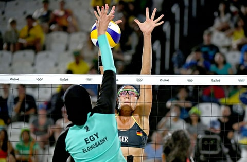 Egypt's Doaa Elghobashy (L) vies with Germany's Kira Walkenhorst during the women's beach volleyball qualifying match between Germany and Egypt at the Beach Volley Arena in Rio de Janeiro on August 7, 2016, for the Rio 2016 Olympic Games.