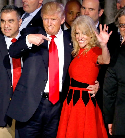 U.S. President-elect Donald Trump, center, gestures to campaign manager Kellyanne Conway, right, during an election night party at the Hilton Midtown hotel in New York, U.S., on Wednesday, Nov. 9, 2016. Trump was elected the 45th president of the United States in a repudiation of the political establishment that jolted financial markets and likely will reorder the nation's priorities and fundamentally alter America's relationship with the world.