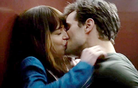 dakota johnson and jamie dornan in 50 shades kissing