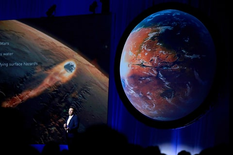Elon Musk, chief executive officer for Space Exploration Technologies Corp. (SpaceX), speaks during the 67th International Astronautical Congress (IAC) in Guadalajara, Mexico, on Tuesday, Sept. 27, 2016. Musk's vision for building a self-sustaining city on Mars will require full rocket reusability, refueling the spacecraft in orbit and propellant production on the Red Planet.