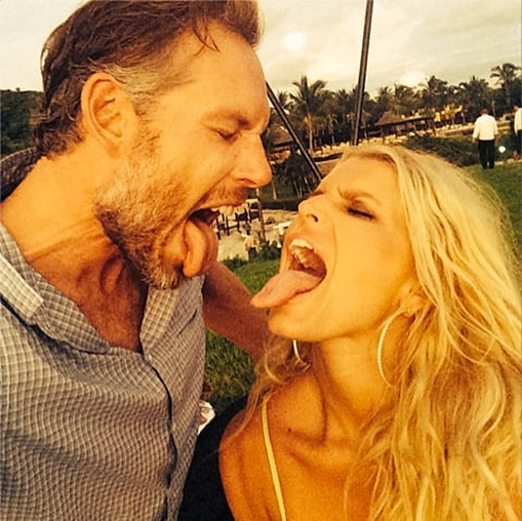 eric johnson and jessica simpson sticking out tongues