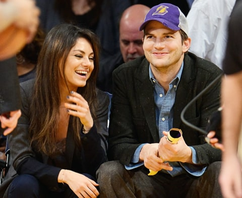 ashton and mila at Lakers game