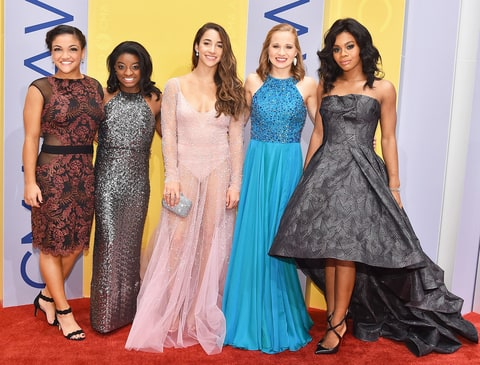 Laurie Hernandez, Simone Biles, Aly Raisman, Madison Kocian and Gabby Douglas (rom left) attend the 50th annual CMA Awards at the Bridgestone Arena on Nov. 2, 2016, in Nashville.