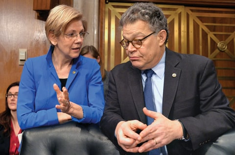 Massachusetts Sen. Elizabeth Warren (L) and Minnesota Sen. Al Franken confer during a break in the hearing for Georgia Rep. Tom Price, nominated to be the next secretary for Health and Human Services, during Senate Health, Education, Labor and Pensions Committee confirmation hearings, on Capitol Hill, January 18, 2017, in Washington, DC.