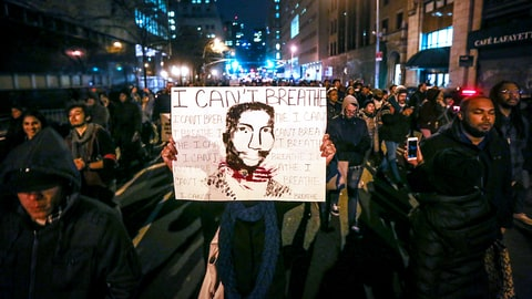 NEW YORK, NY - DECEMBER 04: Hundreds of protestors gather at Foley Square in New York, United States on December 04, 2014. A Staten Island grand jury voted against criminal charges for New York City Police a white police officer Daniel Pantaleo who was accused of using a chokehold during an arrest of Eric Garner. (Photo by Cem Ozdel/Anadolu Agency/Getty Images)