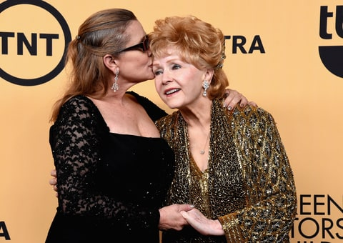 Actress Carrie Fisher (L) and honoree Debbie Reynolds pose in the press room at the 21st Annual Screen Actors Guild Awards at The Shrine Auditorium on January 25, 2015 in Los Angeles, California.