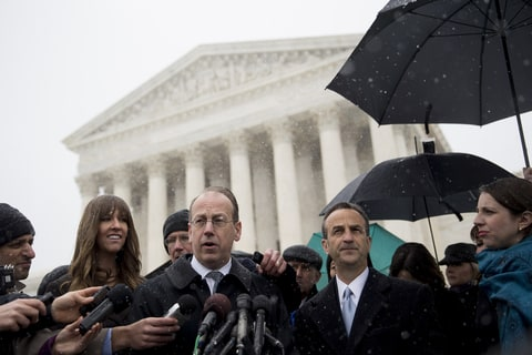 Paul Clement, lawyer arguing before the U.S. Supreme Court on behalf of Hobby Lobby Stores Inc. and Conestoga Wood Specialties Corp., center, speaks to the media with David Cortman, senior counsel and vice-president of religious liberty with Alliance Defending Freedom, right, following arguments in Washington, D.C., U.S., on Tuesday, March 25, 2014. A divided U.S. Supreme Court debated whether companies can assert religious rights, hearing arguments in an ideological clash over President Barack Obama's health care law and rules that promote contraceptive coverage.