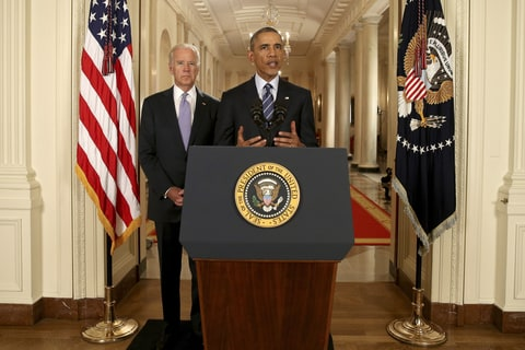 President Barack Obama, standing with Vice President Joe Biden, conducts a press conference in the East Room of the White House in response to the Iran Nuclear Deal, on July 14, 2015 in Washington, DC. The landmark deal will limit Iran's nuclear program in exchange for relief from international sanctions. The agreement, which comes after almost two years of diplomacy, has also been praised by Iranian President Hassan Rouhani.