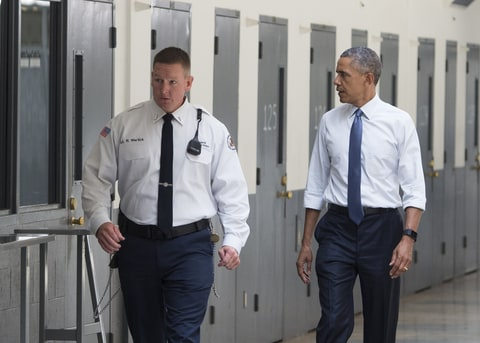 US President Barack Obama, alongside Ronald Warlick (L), a correctional officer, tours a cell block at the El Reno Federal Correctional Institution in El Reno, Oklahoma, July 16, 2015. Obama is the first sitting US President to visit a federal prison, in a push to reform one of the most expensive and crowded prison systems in the world.