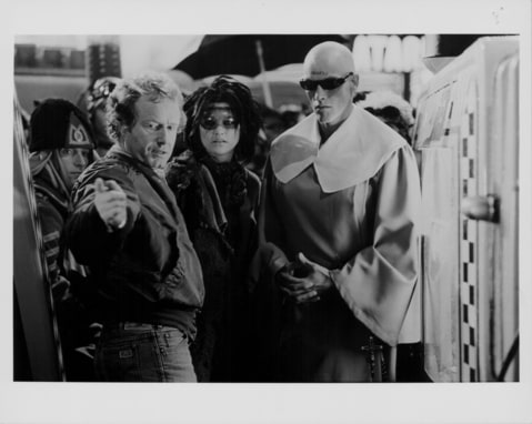 Director Ridley Scott, with supporting actors in costume, on the set of movie 'Blade Runner', 1982.