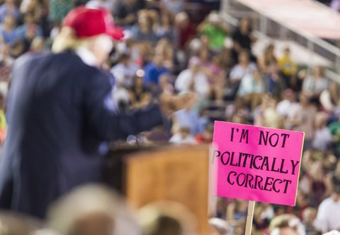 supporter holds up a sign as Republican presidential candidate Donald Trump speaks during a rally at Ladd-Peebles Stadium on August 21, 2015 in Mobile, Alabama. The Trump campaign moved tonight's rally to a larger stadium to accommodate demand.