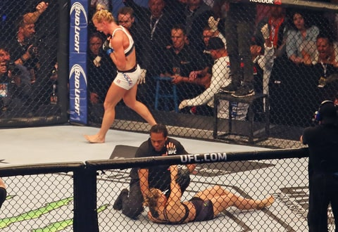 Holly Holm celebrates her victory over Ronda Rousey at UFC 193.