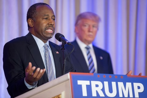 Ben Carson, retired neurosurgeon and former 2016 Republican presidential candidate, left, speaks as Donald Trump, president and chief executive of Trump Organization Inc. and 2016 Republican presidential candidate, right, listens during a news conference at the Mar-A-Lago Club in Palm Beach, Florida, U.S., on Friday, March 11, 2016. Carson, who recently ended his quest for Republican presidential nomination, endorsed his onetime rival Donald Trump Friday striking a blow to presidential candidate Senator Ted Cruz, who had courted Carson because they appeal to many of the same religious-minded voters.