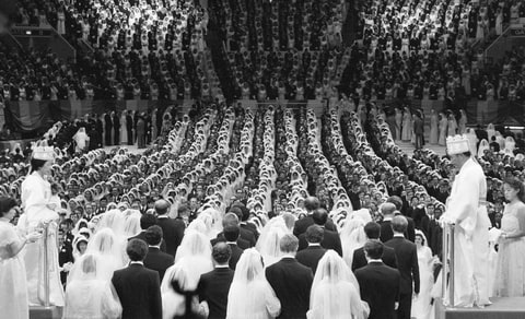 Unification Church leader Reverend Sun Myung Moon and his wife marry 2,075 pairs of his followers at Madison Square Garden on New Years Day, 1982.