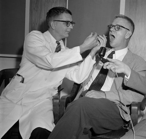 11/27/55 - Dr. Harry L. Williams (left) administers LSD 25 (lysergic acid diethylamide) to Dr. Carl Pfeiffer, chairman of Emory University's Pharmacological Department, to produce effects similar to those experienced by schizophrenics.