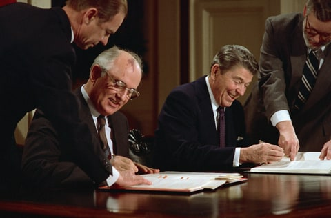 President Ronald Reagan and Soviet General Secretary Mikhail Gorbachev signing the arms control agreement banning the use of intermediate-range nuclear missles, the Intermediate Nuclear Forces Reduction Treaty.